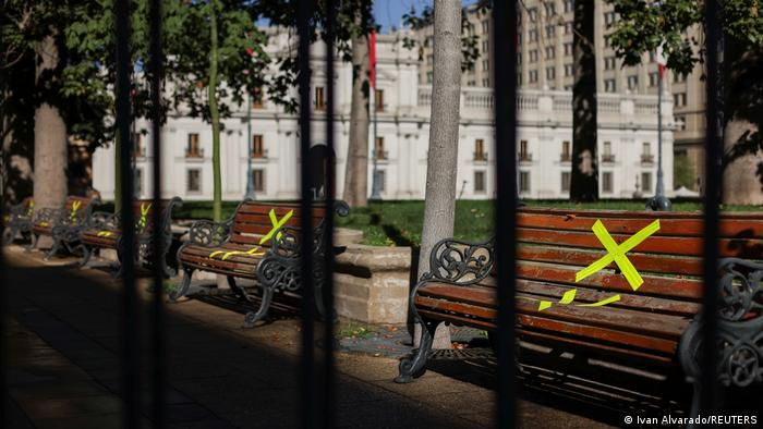 Benches that have been taped off in front of the government palace in Santiago
