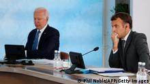 US President Joe Biden (L) and France's President Emmanuel Macron (R) attend a plenary session during G7 summit in Carbis Bay, Cornwall on June 13, 2021. (Photo by PHIL NOBLE / POOL / AFP) (Photo by PHIL NOBLE/POOL/AFP via Getty Images)