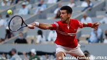 Tennis - French Open - Roland Garros, Paris, France - June 11, 2021 Serbia's Novak Djokovic in action during his semi final match against Spain's Rafael Nadal REUTERS/Gonzalo Fuentes
