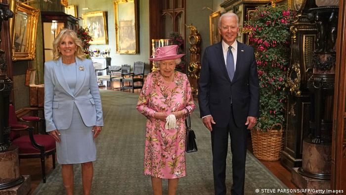 US President Joe Biden (R) and US First Lady Jill Biden (L) pose for a photograph with Britain's Queen Elizabeth II (C) in the Grand Corridor at Windsor Castle in Windsor