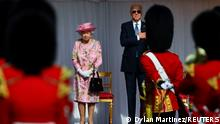 Britain's Queen Elizabeth and U.S. President Joe Biden stand in front of members of the Royal Guard, as they meet at Windsor Castle in Windsor, Britain, June 13, 2021. REUTERS/Dylan Martinez