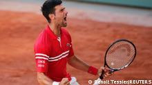 Tennis - French Open - Roland Garros, Paris, France - June 13, 2021 Serbia's Novak Djokovic celebrates winning the final against Greece's Stefanos Tsitsipas REUTERS/Benoit Tessier