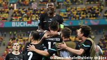 Michael Gregoritsch of Austria celebrates with David Alaba and team mates