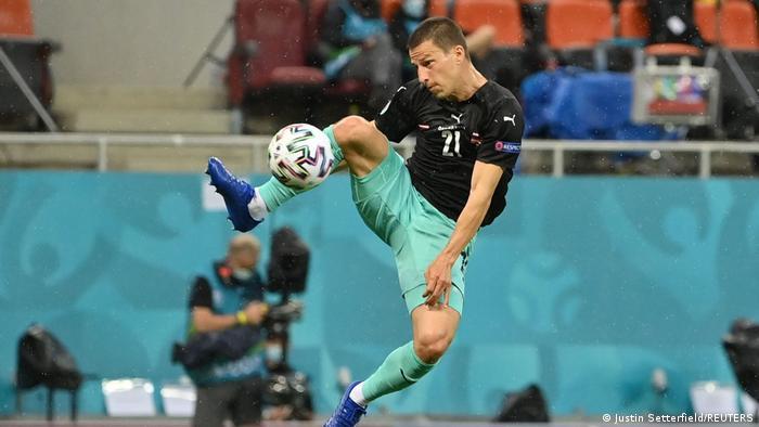 Stefan Laimer, of Borussia Mönchengladbach, scores a delightful opener for Austria