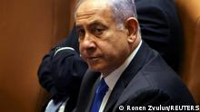 Israeli Prime Minister Benjamin Netanyahu looks on during a special session of the Knesset, Israel's parliament, whereby a confidence vote will be held to approve and swear-in a new coalition government, in Jerusalem June 13, 2021. REUTERS/Ronen Zvulun