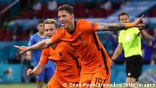 AMSTERDAM, NETHERLANDS - JUNE 13: Wout Weghorst of Netherlands celebrates after scoring their side's second goal during the UEFA Euro 2020 Championship Group C match between Netherlands and Ukraine at the Johan Cruijff ArenA on June 13, 2021 in Amsterdam, Netherlands. (Photo by Dean Mouhtaropoulos/Getty Images)