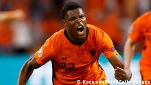 AMSTERDAM, NETHERLANDS - JUNE 13: Denzel Dumfries of Netherlands celebrates after scoring their side's third goal during the UEFA Euro 2020 Championship Group C match between Netherlands and Ukraine at the Johan Cruijff ArenA on June 13, 2021 in Amsterdam, Netherlands. (Photo by Koen van Weel - Pool/Getty Images)