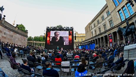 Iranian director Mohammad Rasoulof on a the screen of an open-air cinema.