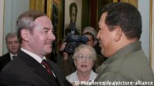 epa00963383 Venezuelan President Hugo Chavez (R) embraces the Secretary of State for Belarus Viktor Sheiman (L) during his visit to the Presidential Palace in Caracas, Venezuela, Wednesday 21 March 2007. Last July 2006, Chavez became the first Latin American President to visit Belarus and signed joint declarations with its President, Alexander Lukashenko. EPA/MIRAFLORES - HANDOUT EDITORIAL USE ONLY