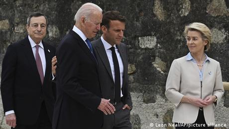 Italian Prime Minister Mario Draghi, US President Joe Biden, President of France, Emmanuel Macron and European Commission Ursula von der Leyen speak after a photo session during the G7 Summit