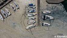 Aerial view of boats docked to a marina covered by sea snot, a thick slimy layer of the organic matter also known as marine mucilage, spreading through the Sea of Marmara and posing a threat to marine life and the fishing industry, in Istanbul, Turkey June 13, 2021. Picture taken with a drone. REUTERS/Umit Bektas