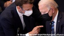 U.S. President Joe Biden, right, speaks with French President Emmanuel Macron during a plenary session during a NATO summit at NATO headquarters in Brussels, Monday, June 14, 2021. U.S. President Joe Biden is taking part in his first NATO summit, where the 30-nation alliance hopes to reaffirm its unity and discuss increasingly tense relations with China and Russia, as the organization pulls its troops out after 18 years in Afghanistan. (Brendan Smialowski, Pool via AP)