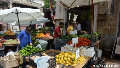 People buy fruit and vegetables in a shop close to the old souk of Sidon (or Saida), the third-largest city in Lebanon