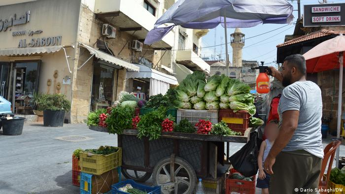 A street vendor freshens up vegetables close to the entrance of the old souk of Sidon (or Saida), the third-largest city in Lebanon.
