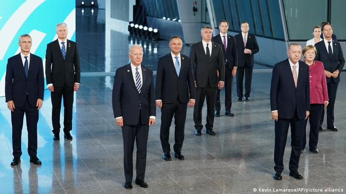 The leaders of NATO countries stand socially distanced in Brussels