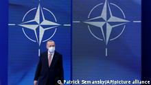 Turkish President Recep Tayyip Erdogan arrives to pose for photos with NATO Secretary General Jens Stoltenberg at the NATO summit at NATO headquarters in Brussels, Monday, June 14, 2021. (AP Photo/Patrick Semansky, Pool)