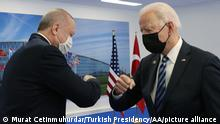 BRUSSELS, BELGIUM - JUNE 14: (----EDITORIAL USE ONLY – MANDATORY CREDIT - TURKISH PRESIDENCY / MURAT CETINMUHURDAR / HANDOUT - NO MARKETING NO ADVERTISING CAMPAIGNS - DISTRIBUTED AS A SERVICE TO CLIENTS----) Turkish President Recep Tayyip Erdogan (L) greets US President Joe Biden (R) at the NATO summit at the North Atlantic Treaty Organization (NATO) headquarters in Brussels, on June 14, 2021. Turkish Presidency / Murat Cetinmuhurdar / Handout / Anadolu Agency