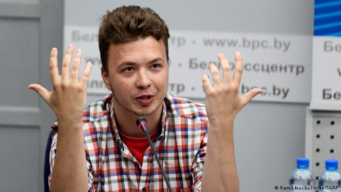 Belarusian dissident journalist Raman Pratasevich gestures while speaking at a news conference at the National Press Center of Ministry of Foreign Affairs in Minsk