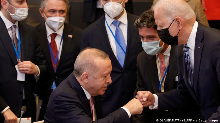 Turkish President Recep Tayyip Erdogan and US President Joe Biden bumping fists
