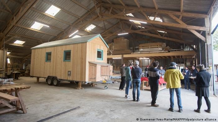 A tiny house in the production phase in a large workshop