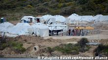 Migrants gather outside their tents at Karatepe refugee camp, on the eastern Aegean island of Lesbos, Greece, Monday, March 29, 2021. The European Union's home affairs commissioner is visiting asylum-seeker facilities on the eastern Greek islands of Samos and Lesbos amid continuing accusations against Greece of illegal summary deportations. (AP Photo/Panagiotis Balaskas)