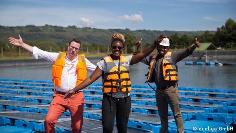Workers on a floating solar farm in Kenya