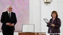 German President Frank-Walter Steinmeier presents the the Grand Cross of the Order of Merit of the Federal Republic of Germany to Belarusian Nobel literature laureate Svetlana Alexievich, at Bellevue Palace in Berlin, Germany June 15, 2021. REUTERS/Annegret Hilse