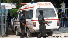 An ambulance carrying wounded from a suicide bombing attack at a military base arrives at the Madina Hospital in Mogadishu, Somalia June 15, 2021. REUTERS/Feisal Omar