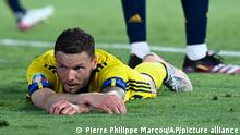 Sweden's Marcus Berg lying on the turf after missing a golden chance against Spain