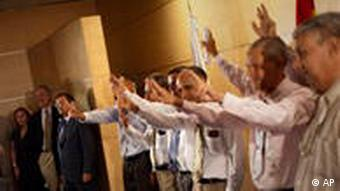 Cuban political prisoners wave at a press conference
