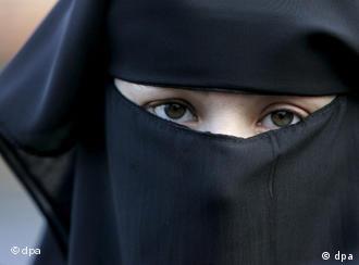 a woman in a black burqa