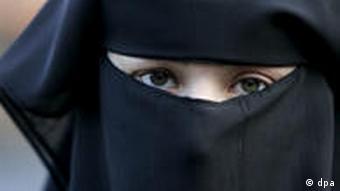 A woman wearing a burqa