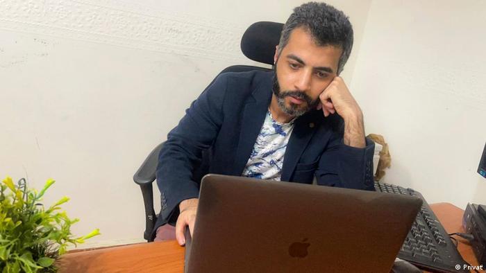 Mohamed Elyamani sits at a computer
