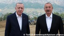Azerbaijani President Ilham Aliyev, right, and Turkey's President Recep Tayyip Erdogan, pose for photos outside Shusha, in Nagorno-Karabakh, Azerbaijan, Tuesday, June 15, 2021. Shusha, a culturally revered city that Azerbaijan liberated from Armenian forces in last autumn's war. Shusha, a center of Azerbaijani Turkish culture for centuries, came under Armenian control in 1992 in fighting over the separatist Nagorno-Karabakh region.(Turkish Presidency via AP, Pool)