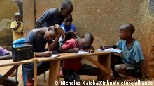 (210615) -- KAMPALA, June 15, 2021 (Xinhua) -- Children listen to a radio program in Kampala, Uganda, June 14, 2021. Radio lessons for students in middle grades of primary schools in Uganda resumed on Monday following the closure of schools due to the COVID-19 pandemic. (Photo by Nicholas Kajoba/Xinhua)
