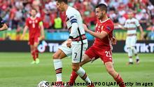 Portugal's forward Cristiano Ronaldo (L) vies with Hungary's defender Endre Botka during the UEFA EURO 2020 Group F football match between Hungary and Portugal at the Puskas Arena in Budapest on June 15, 2021. (Photo by Attila KISBENEDEK / POOL / AFP) (Photo by ATTILA KISBENEDEK/POOL/AFP via Getty Images)