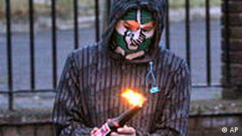 A masked youth prepares to throw a petrol bomb on Tuesday