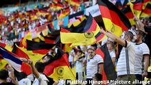 German football fans await the start of the Euro 2020 soccer championship group F match between France and Germany at the Allianz Arena stadium in Munich, Tuesday, June 15, 2021. (Matthias Hangst/Pool via AP)