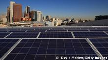 LOS ANGELES, CA - OCTOBER 28: Solar panels cover the rooftop of the Staples Center sports complex on October 28, 2008 in Los Angeles, California. The off-grid 345-kilowatt 1,727-panel photovoltaic solar system, which covers 24,196 square feet, will provide power to Staples Center and the new Nokia Theatre L.A. Live sports and entertainment venues. (Photo by David McNew/Getty Images)