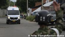 A soldier signals an ambulance