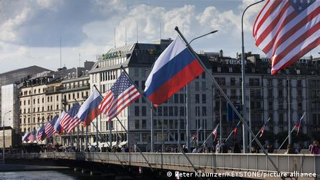 Flags of the US and Russia on the Mont Blanc bridge in Geneva, Switzerland