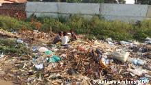 Angola Kinder auf einer Müllhalde