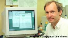 Tim Berners-Lee and a computer from the 1990s.
