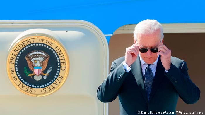 Biden in sunglasses arriving on Air Force One plane