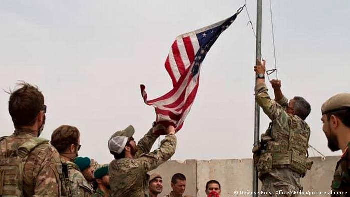 US troops take down flag in Afghanistan