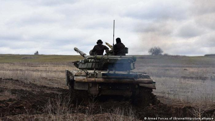 Ukrainian army conduct a drill with military tanks while military activity continues in the Donbas region