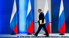 Russian President Vladimir Putin leaves the hall after his annual state of the nation address in Manezh, Moscow, Russia, Wednesday, April 21, 2021. Putin's state-of-the-nation speech comes amid a new surge in tensions with the West over a Russian troop buildup near the border with Ukraine and a hunger strike by jailed Russian opposition leader Alexei Navalny protesting a lack of adequate medical treatment in prison. (AP Photo/Alexander Zemlianichenko)