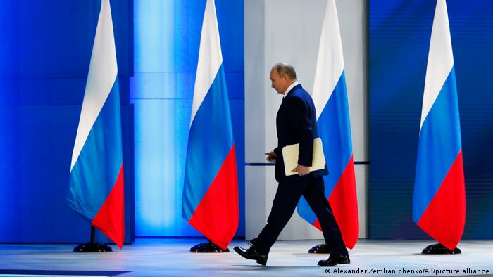 Russian President Vladimir Putin leaves the hall after his annual state of the nation address in Manezh, Moscow, Russia, Wednesday, April 21, 2021