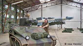 Inflatable rubber tank decoy and Soviet-built surface-to-air missile battery in a hangar