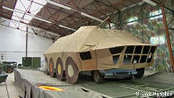 East German Trabant car underneath a canvass replica of a Soviet armoured vehicle.